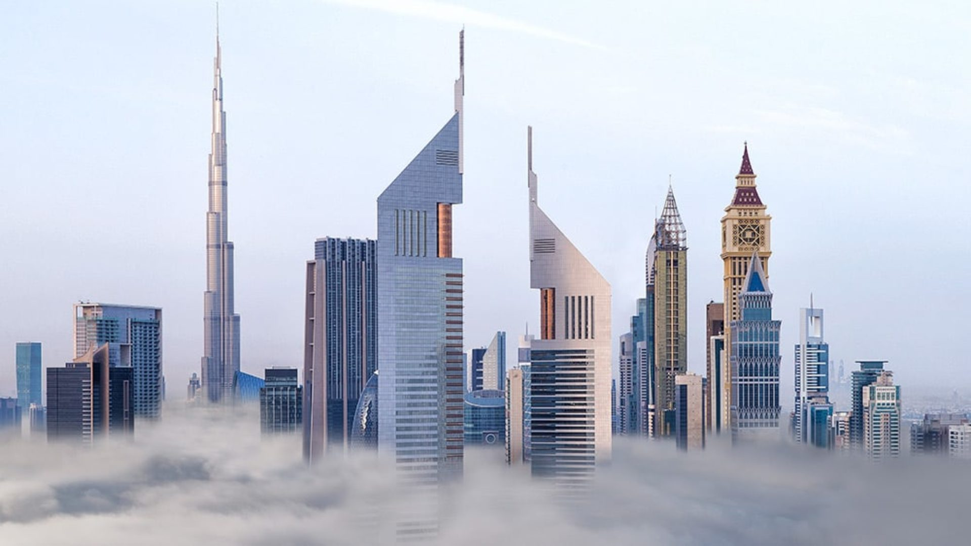 Aerial view of Jumeirah Emirates Towers in the clouds